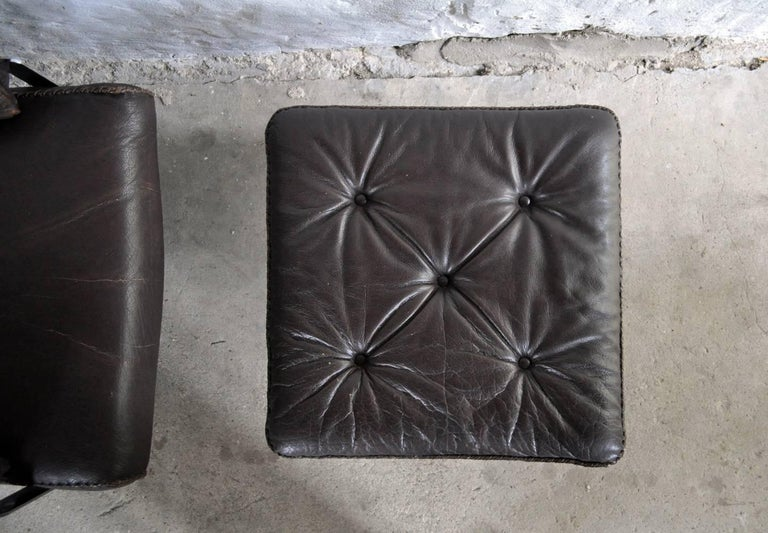 Metal Dark Brown Leather and Chrome Lounge Chair and Stool by Arne Norell For Sale
