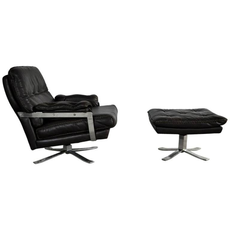 Dark Brown Leather and Chrome Lounge Chair and Stool by Arne Norell For Sale