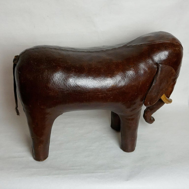 Mid-Century Modern Dark Brown Leather Elefant Footstool by Dimitri Omersa for Abercrombie & Fitch For Sale