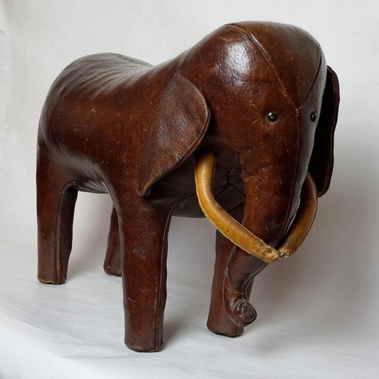 British Dark Brown Leather Elefant Footstool by Dimitri Omersa for Abercrombie & Fitch For Sale