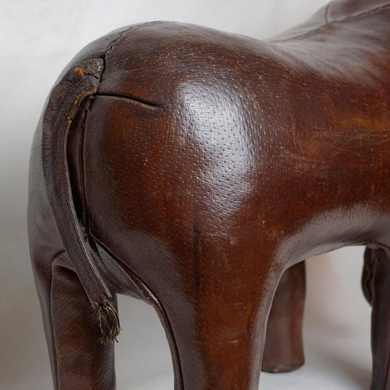 Mid-20th Century Dark Brown Leather Elefant Footstool by Dimitri Omersa for Abercrombie & Fitch For Sale