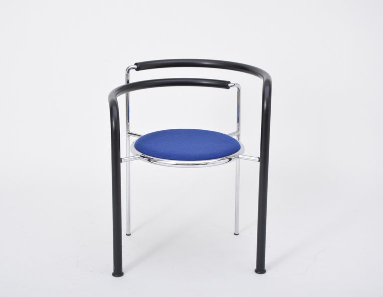 This chair was designed by Rud Thygesen & Johnny Sorensen. It was produced by Botium in Denmark, circa 1989. The legs are coated with black PVC and the seat is covered with blue fabric. The model is called Dark Horse.