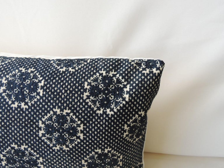 Embroidery fez antique textile bolster pillow. Dark indigo embroidery large fez bolster pillow with natural linen frame and backing. Pillow handmade and designed in the USA. Closure by stitch (no zipper) with custom made pillow insert. Ideal for a