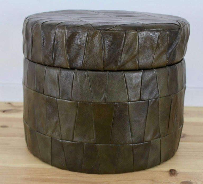 Patchwork leather ottoman by De Sede in olive. Ottoman has storage inside. Good condition. Great accent piece and nice scale.  Multiple De Sede leather ottomans available in our other listings.