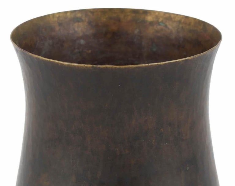 Dark patina brass vase is an original decorative work realized in the second third of the 20th century.  Original brass.   Designed by Eugen Zint.   Made in Germany.   Good conditions: Slight signs of age.  Beautiful brass vase realized in
