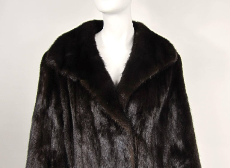 Stunning Classic Mink Coat. Straight cut, timeless. Soft and supple. Very Deep color on this one. Velvet lined pockets with a 2 clip closure. This is not monogrammed. Measurements up to 40-inch chest, up to 42-inch waist, up to 48-inch hips, 23-inch