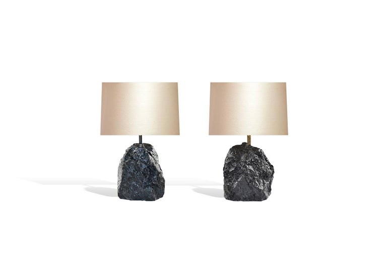 Pair of natural rock crystal sculpture mounted as lamp with antique brass light setting.