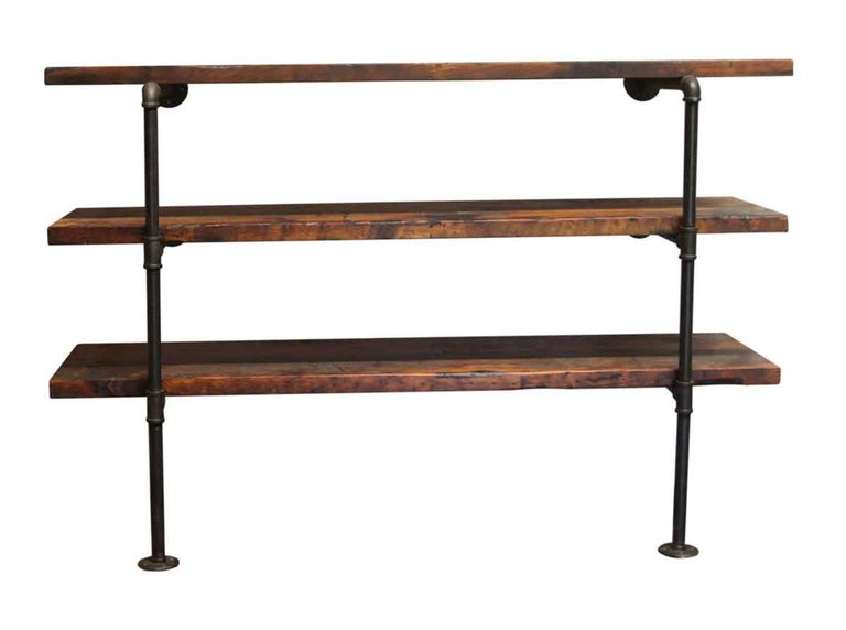 Industrial Dark Stained Pine Shelf Unit with Pipe Legs For Sale