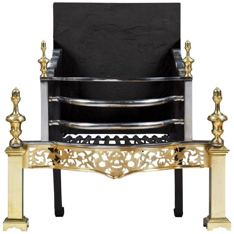 A brass and polished steel fire basket with pierced, serpentine apron in the time honoured 18th century Country House style. Â.