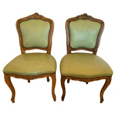 Darling Pair of French Antique Light Green Leather Carved Walnut Side Chairs