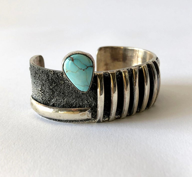 Native American sterling silver cuff bracelet with candelaria turquoise designed by Darrin Livingston. Bracelet measures 1