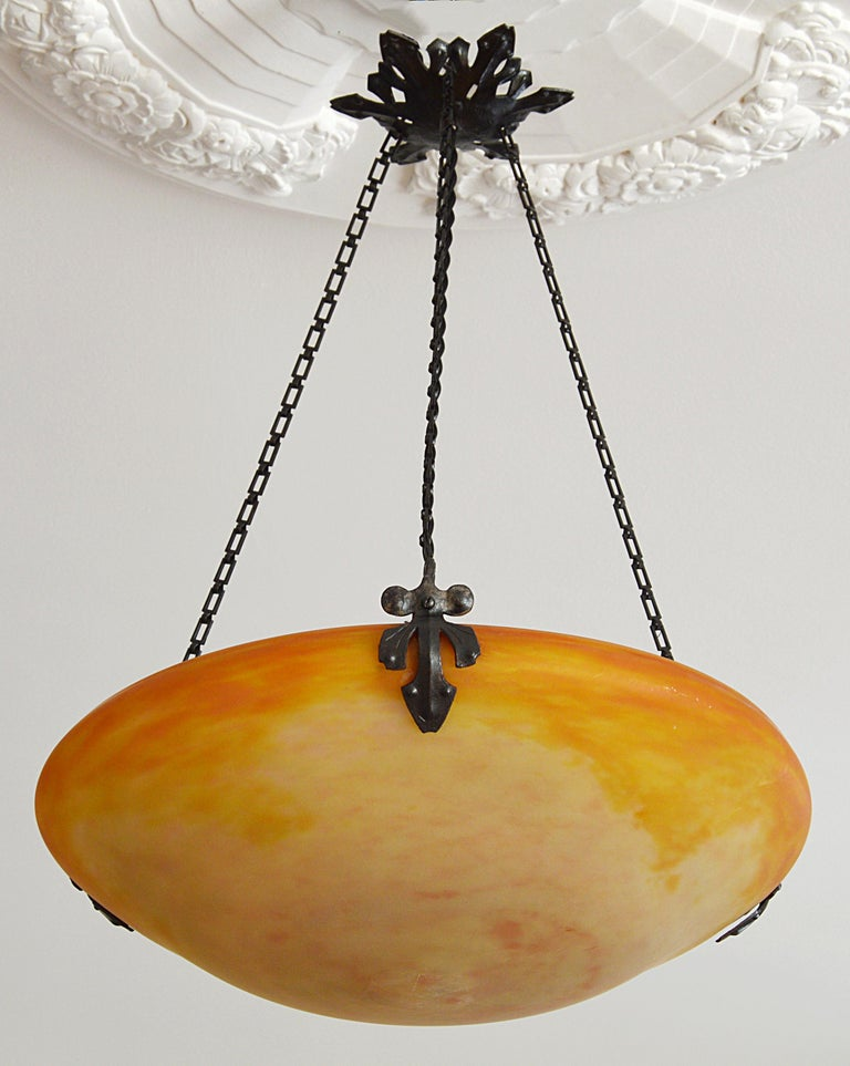 Any fair offer will be examined with the utmost attention, please send a message. French pendant chandelier by Daum (Nancy), France, 1900-1905. Blown double glass shade hung at its original wrought iron frame. Colors: pink, yellow, orange and white.