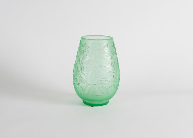 The process used on this particular vase is acid etching, involving the dissolution of silica into an acidic mixture, and the application of this mixture to this glass after blowing and cooling. The technique was typical of Daum, in the attempt to