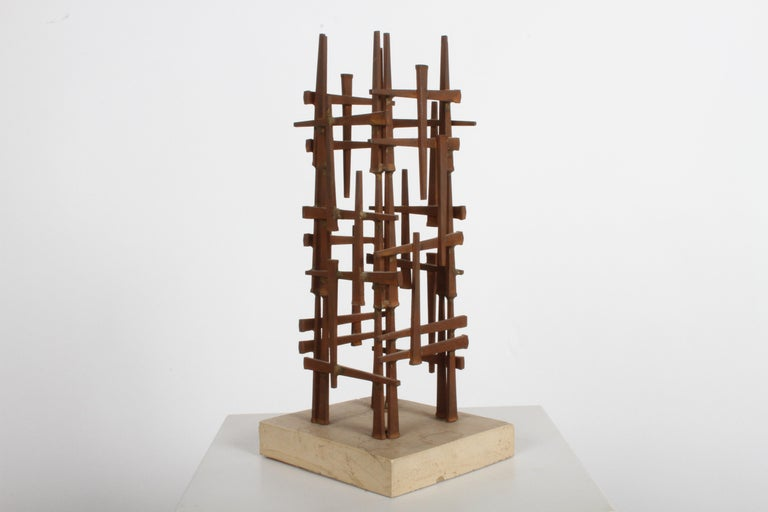 St. Louis designer / artist Dave Grossman designs, made these sculptures in the late 1960s and early 1970s in the Brutalist style, using welded square nails on cast base. Great coffee table or book shelf sculpture. In the style of Marc Weinstein,
