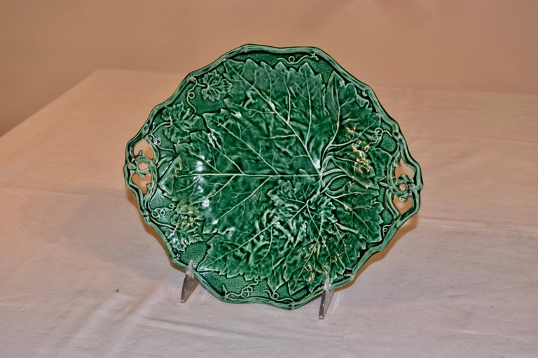Davenport double handled Majolica dish with Davenport impressed mark and the year for 1852 stamped on the back. Gorgeous pattern with leaves and vines.