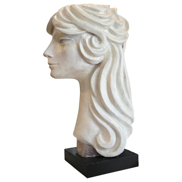 Modern abstract cast stone portrait bust sculpture by Houston, Texas artist David Adickes. The work is modeled after Adickes' friend Julie Burrows and features sharp facial features framed by swooping hair. Signed by artist on the back of the neck.