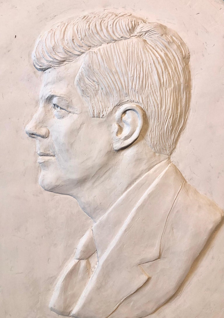 David Pryor Adickes American (b. 1927) John F. Kennedy bas-relief plaster relief sculpture in artists frame incised signature lower center. with gold stars. Deep relief, approximately 1 inch deep Provenance: from the collection of Francine Coffey