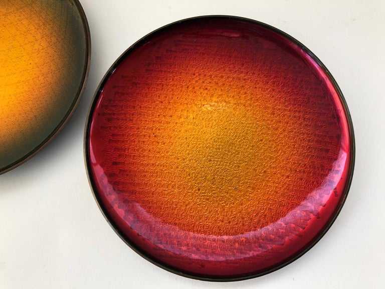 Pair of Norwegian enamel over copper trays or plates by David Andersen, circa 1960s. Plates have good weight and also have a hanging device on the bottom. Measuring 8.25