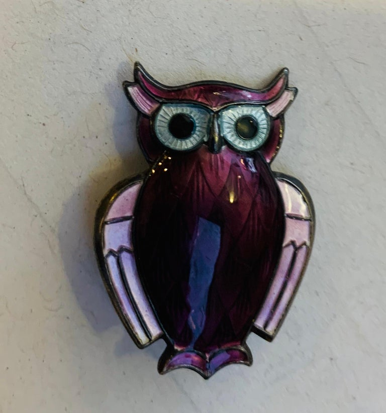 1960s sterling silver owl brooch with purple enamel by Norwegian jewel brand David Andersen. The brooch is sealed on the back.  Weight: 9.2 g. (0.32 oz.).