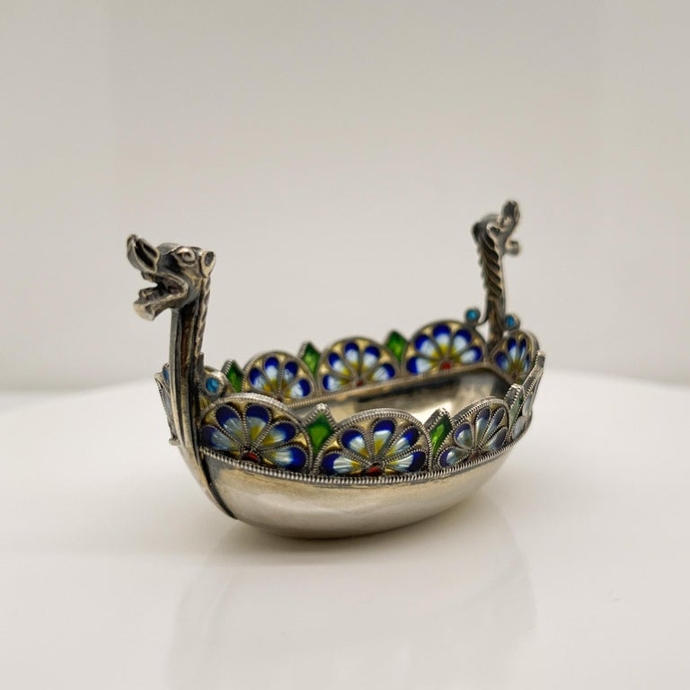 A very fine sterling silver and plique a jour enamel salt cellar.  Modeled as a Viking boat.  With remnants of its original gilding.  Simply a terrific piece!  Date: Late 19th or Early 20th Century  Overall Condition: It is in overall good,