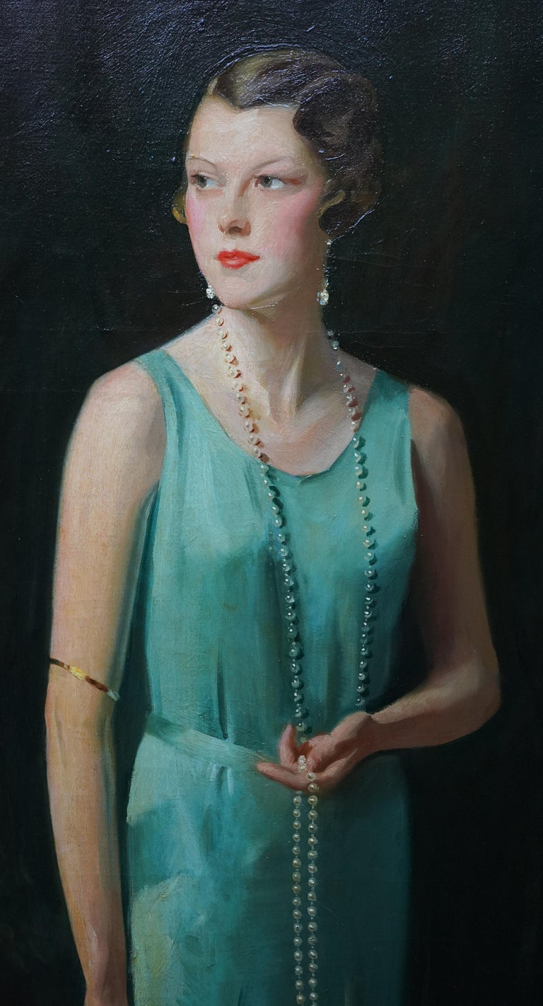 This impressive large portrait oil painting is by noted Scottish artist David Cowan Dobson. Painted in 1930, it is a wonderful three quarter length Art Deco portrait of Sarah Ogden Taylor who became Lady McKinstry. She is wearing a silk green dress