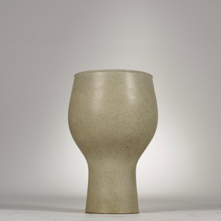 Rare David Cressey chalice planter with a sang beige glaze. Made apart of the Pro/Artisan Stoneware collection in 1963 for Architectural Pottery, exemplifying a beautiful shape.