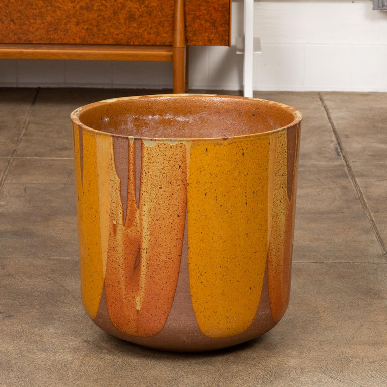 "A tulip-shaped LT-24 planter for Architectural Pottery with David Cressey's Pro/Artisan ""Flame Glaze."" This planter shape was designed by Malcolm Leland and has a rounded bottom that widens towards the opening, a simple shape rendered dramatic by"