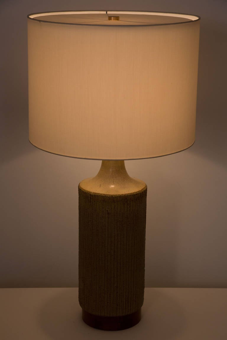 Textured ceramic table lamp with walnut base.