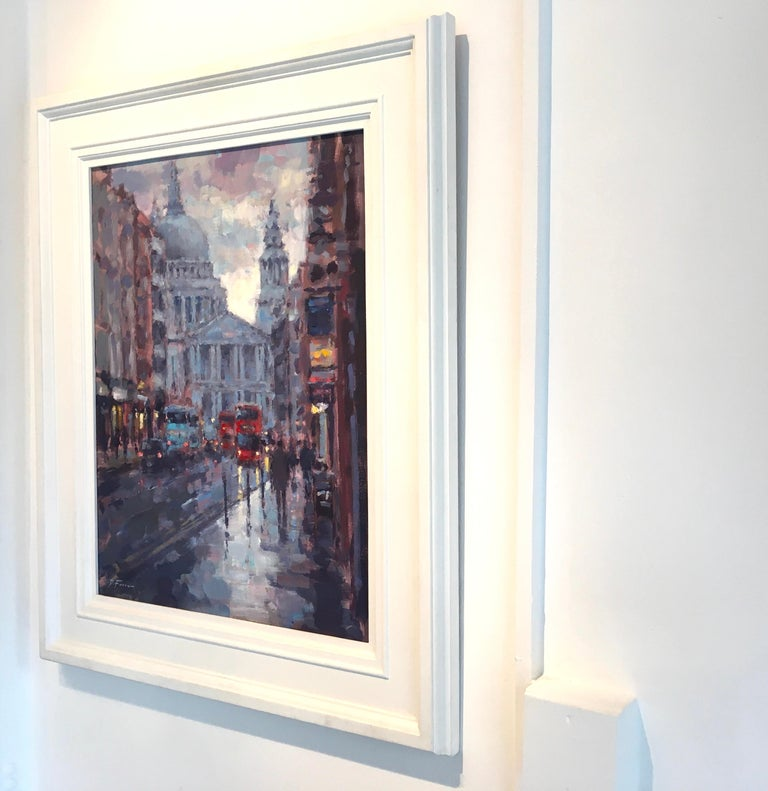 The original city landscape painting by David Farren is framed in a white flat frame. The artwork is signed,  stringed and ready to be displayed. Through the contrasting use of darks and lights the artist perfectly captures the reflections on the