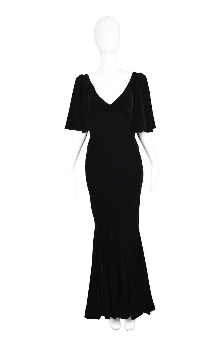 "David Fielden Vintage Black Velvet Butterfly Sleeve Plunging Back Evening Gown, 1980s  Estimated Size: UK 10/ US 6/ EU 38. Please check measurements.   Bust - 34"" / 86cm Waist -  28"" / 71cm Hips - 36"" / 91cm Length (Shoulder to Hem) - 63"" /"