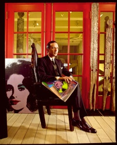 Fred Hughes in Andy Warhol's Factory with Liz Taylor Painting