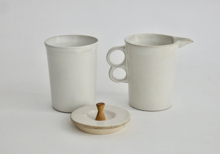 Lidded sugar container and creamer with trademark David Gil stacked circle handles. Incised stamp Bennington Potters.