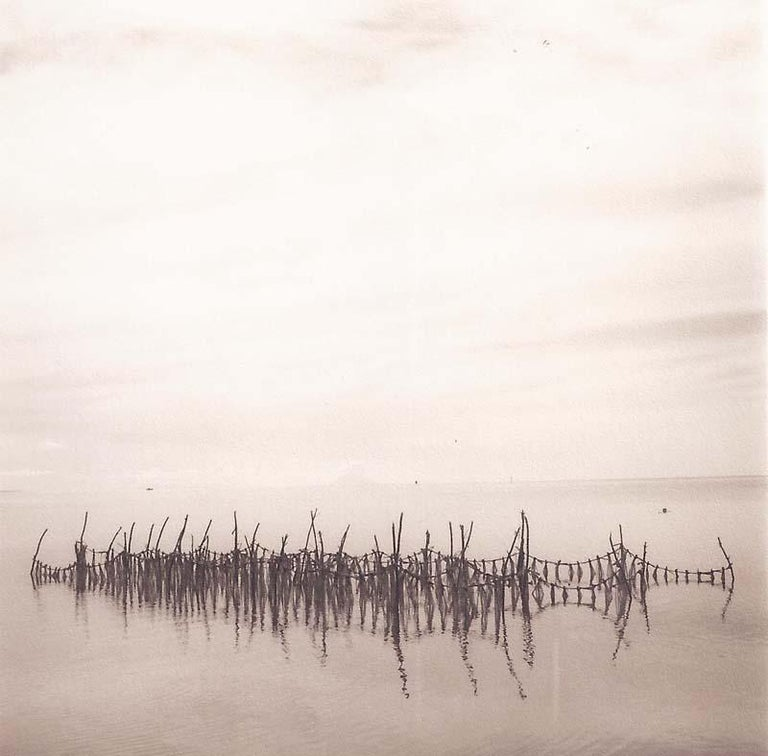David Halliday Still-Life Photograph - Fish Net Light (Sepia Toned Landscape of Net in Water and Reflection from Tonga)