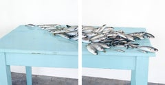 Fish on Blue (Still Life Photograph of Silver Fish on a Pastel Blue Table)