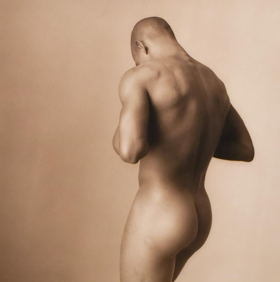 Male Nude with Head Down (Sepia Toned Figurative Photograph by David Halliday)