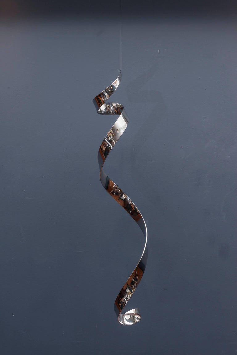Simple and sophisticated chrome hanging sculpture from the