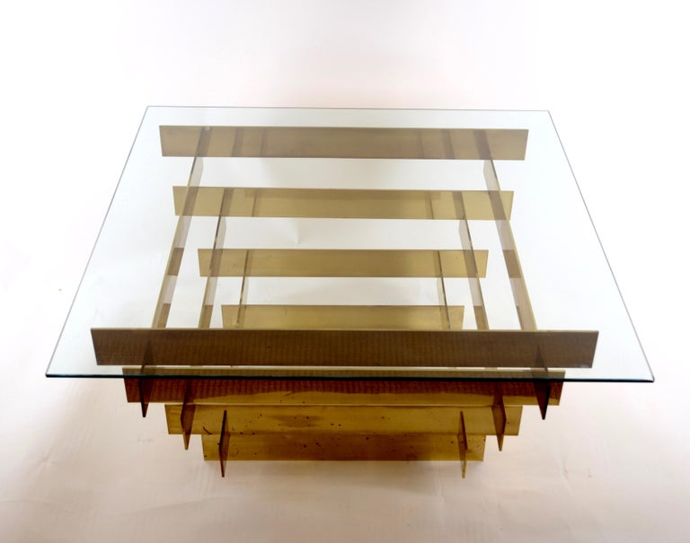 A coffee table designed by David Hicks, circa 1970s. Made in gilt-brass and glass.
