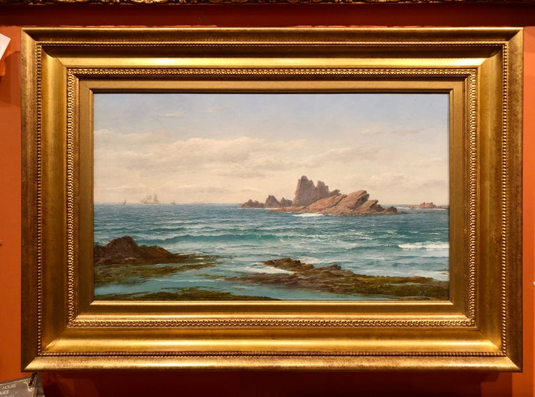 "David James, 1853-1904 was one of the leading painters of seascapes in the late 19th century, and was known as 'Master of the wave"". His skill in painting waves is masterfully demonstrated here in the crisp blue wave about to break on the rocky"