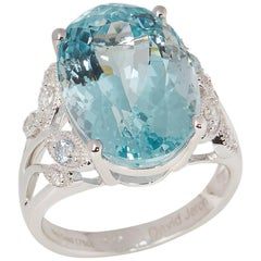 Certified 12.53ct Oval Cut Aquamarine and Diamond 18ct gold Ring