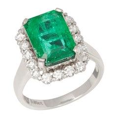 Certified 4.58ct Columbian Emerald Cut Emerald and Diamond 18ct gold Ring