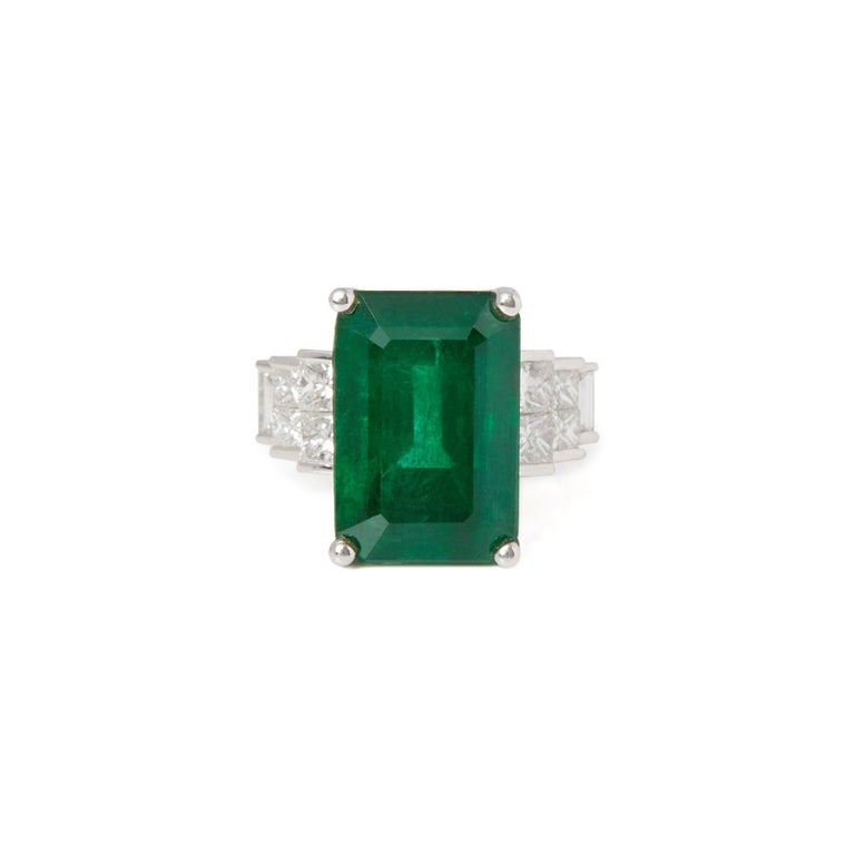 This Ring Designed by David Jerome is from his Private Collection and features One Emerald Cut Emerald Totalling 13.77cts Sourced in the Kagem Mine Zambia. Set with Princess Cut Diamonds Totalling 1.26cts Mounted in an 18k White Gold Art Decco Style