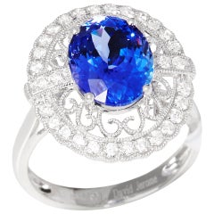 Certified 3.96ct Oval Cut Tanzanite and Diamond 18ct gold RIng