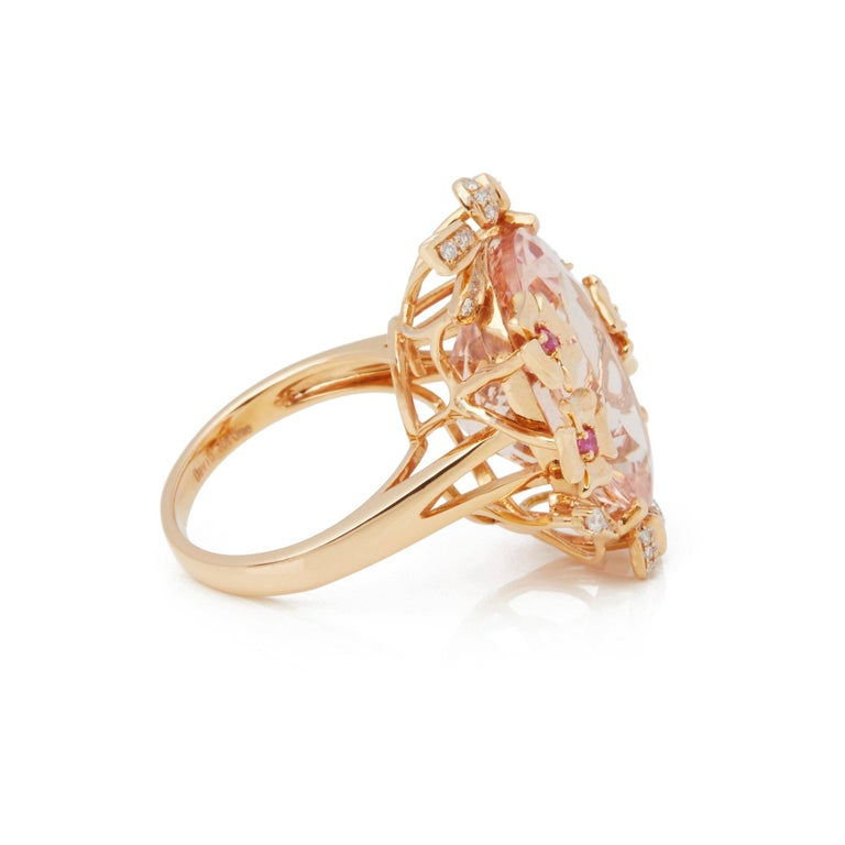 This Ring Designed by David Jerome is from his Private Collection and features One Oval Cut Morganite Sourced in Brazil. Totalling 15.93cts Set with Round Brilliant Cut Diamonds and Pink Sapphires Totalling 0.40cts. Mounted in an 18k Rose Gold