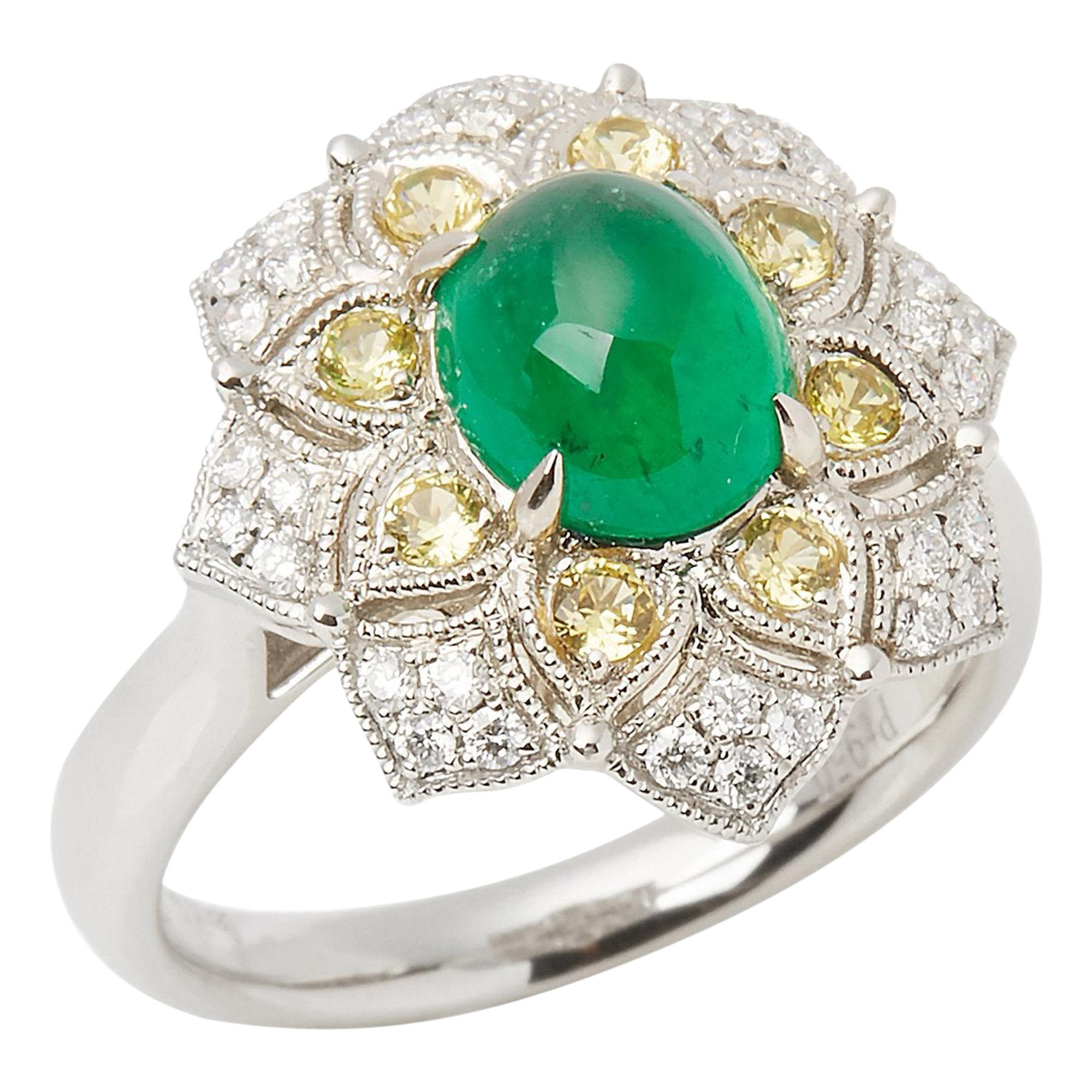 Platinum Emerald, Diamond and yellow Sapphire Cluster Ring