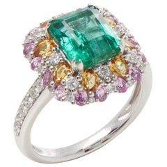 Platinum Emerald, Diamond and Mixed Sapphire Cluster Ring