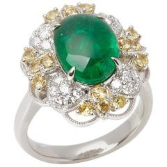 Platinum Emerald, Diamond and yellow Sapphire Cluster Ring