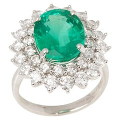 Certified 6.42ct Untreated Oval cut Colombian Emerald and Diamond Platinum Ring