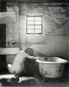 The Bath #1 (Female nude squats near tub in an  abandoned New Orleans row house)