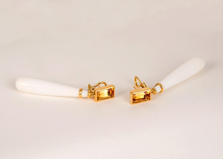 Completely handmade in rich 18k gold. An exceptional matched pair of precious topaz weighing 7.27 carats total weight and sleek elegant cocholong drops are simply chic !!! 2 3/8's in length.