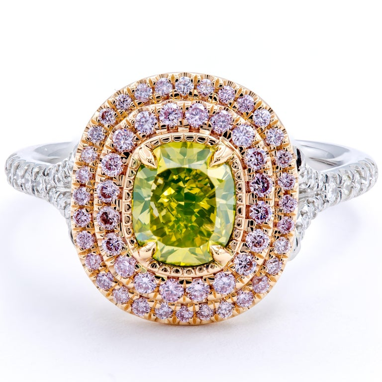Gorgeous rows of natural fancy pink pavé diamonds caress a beautiful natural fancy intense greenish yellow cushion cut diamond center stone. The band uses both platinum and 18Kt white and yellow gold to secure the stones and includes round brilliant